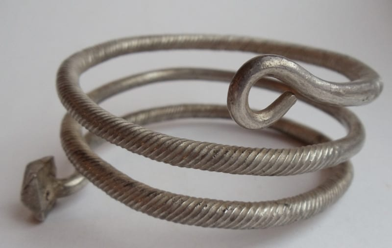"""Photograph of a """"Glazov type"""" silver bracelet, 9th-11th century, weighing 200g."""