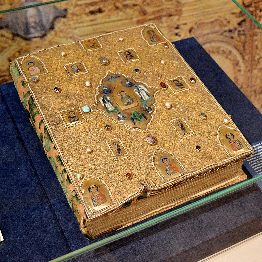 The cover and binding on the Mstislav Gospel (Rus. Мстиславово Евангелие). The manuscript dates to the 12th century. The luxurious cover (Rus. оклад, oklad) was added in the 16th century by order of Ivan the Terrible, and includes several enameled miniatures from the 10th-12th centuries, along with gemstones and pearls. Photo in public domain.